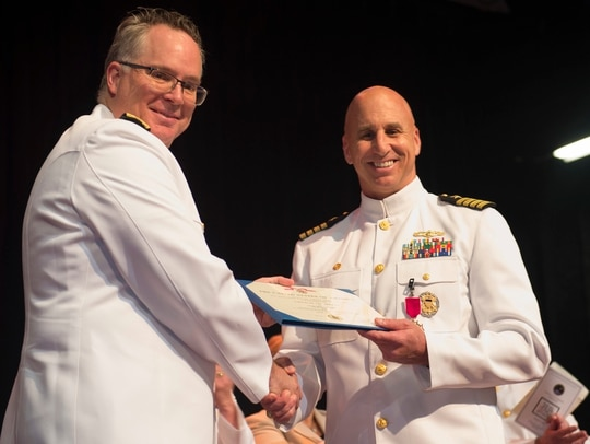 Then Rear Adm. Timothy White (left) assumed command of Fleet Cyber Command in a June 18 ceremony. (U.S. Navy photo by Mass Communication Specialist Seaman Cameron Stoner.)