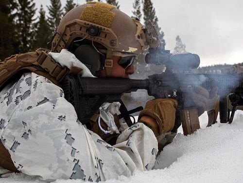 A Marine with Marine Rotational Force-Europe 18.1 sends live rounds down range while conducting a squad attack during winter warfare training at Haltdalen Training Center, Norway, April 18, 2018. (Gunnery Sgt. Clinton Firstbrook/Marine Corps)