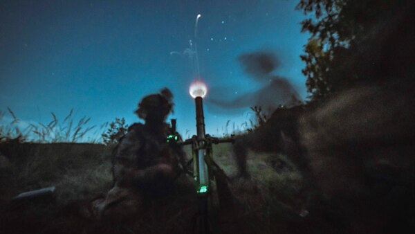 U.S. paratroopers assigned to the 173rd Airborne Brigade fire a M224 60mm mortar under the cover of darkness at Grafenwoehr Training Area, Germany, August 14, 2019. (Sgt. Henry Villarama/Army)
