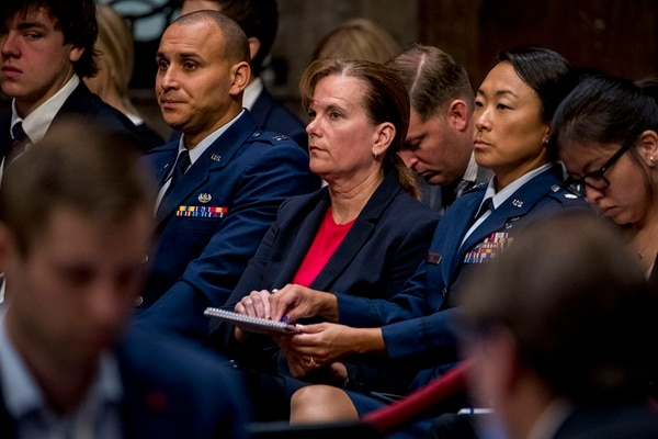 Former aide Army Col. Kathryn Spletstoser sits in the audience as Gen. John Hyten appears before the Senate Armed Services Committee on Capitol Hill in Washington, Tuesday, July 30, 2019, for his confirmation hearing to be vice chairman of the Joint Chiefs of Staff. (Andrew Harnik/AP)