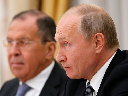 Russian President Vladimir Putin listens to U.S. national security adviser John Bolton during their Oct. 23, 2018, meeting in the Kremlin in Moscow with Russian Foreign Minister Sergey Lavrov, at left. (Alexander Zemlianichenko/AP)