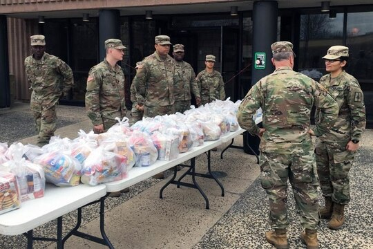New York Army National Guard Soldiers distribute food parcels in Westchester County, N.Y. on March 12, 2020 as part of the New York State response to the effort to contain a cluster of coronavirus, also known as Covid-19, cases in New Rochelle, N.Y. The soldiers and airmen were providing food to families to make up for school lunch and breakfast meals students are missing after schools in New Rochelle were closed to prevent the spread of the virus. (Col. Steve Rowe/Army National Guard)