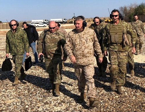 Gen. Frank McKenzie, center front, the top U.S. commander for the Middle East, walks as he visits a military outpost in Syria, Saturday, Jan. 25, 2020. (Lolita Baldor/AP)