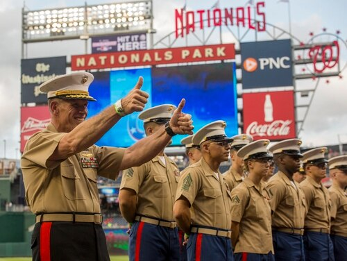 Lt. Gen. Robert Walsh poses for a photo before participating in a pre-game lineup delivery during U.S. Marine Corps Day at Nationals Park in Washington, D.C., July 31. Pentagon Federal Credit Union is offering 100 free tickets every game to service members and families. (Sgt. Robert Knapp/Marine Corps)