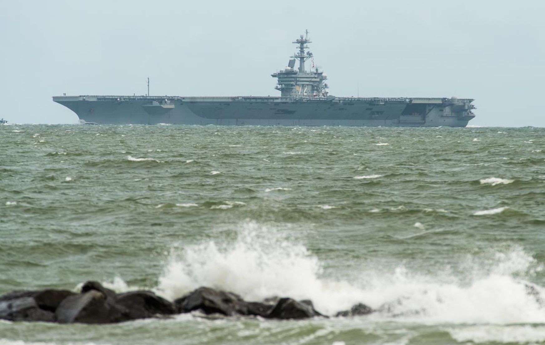 Five days after being the last U.S. Navy ship chased out of Naval Station, Norfolk by Hurricane Florence, the aircraft carrier Abraham Lincoln returns home on Sept. 16, 2018. (Staff)