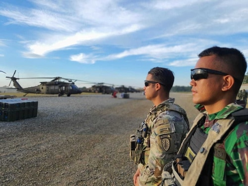 A 5th SFAB team leader, Capt. Kris Candelaria, stands alongside 1st Lt. Rendi Hardika Putera from the Indonesian army as they prepare for an air movement at Fort Polk, Louisiana, Oct. 6. (Army)