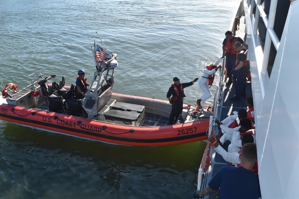 The Coast Guard cutter Winslow Griesser returned 24 migrants to authorities in Santo Domingo on Tuesday. (Coast Guard)