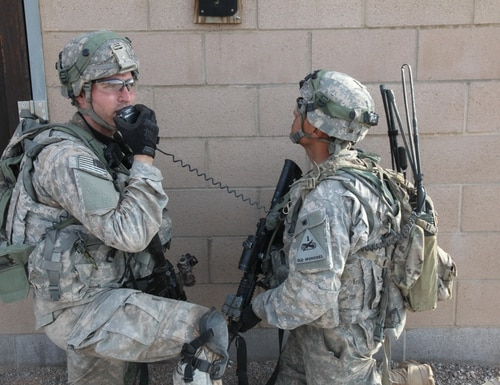 Soldiers use the Manpack Radio, which provides beyond line-of-sight connectivity through multiple waveforms, enabling them to communicate despite obstacles such as buildings and difficult terrain.