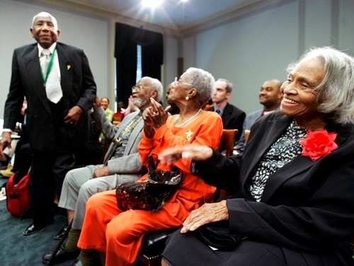 In this May 10, 2005, photo, a survivor of the 1921 Tulsa race riots, Otis Granville Clark, 102, left, acknowledges the introduction, as fellow survivors, Dr. Olivia Hooker, 90, right, and Wess Young, 88, second left, and his wife, Cathryn Young, second right, give their applause at the start of a briefing before members of the Congressional Black Caucus and other leaders on Capitol Hill in Washington. Hooker, one of the last survivors of the race riot, one of the worst race riots in U.S. history, has died at age 103. (Manuel Balce Ceneta/AP)