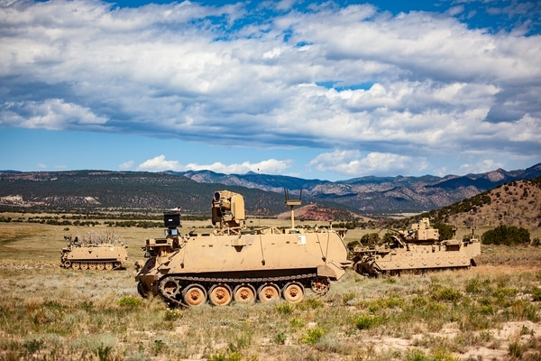 A mission enabling technologies demonstrator, rear, and two robotic combat vehicles maneuver through a Fort Carson, Colo., training area at the control of soldiers. (Sgt. Liane Hatch/U.S. Army)