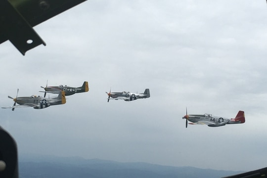 Four P-51 Mustangs fly in formation over Virginia alongside B-29 Superfortress named Doc. Howard Altman/staff