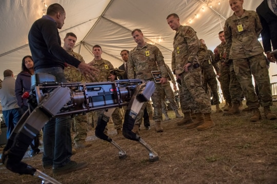 Jiren Parikh, Ghost Robotics CEO, briefs service members on the capabilities of the Robodogs during the Advanced Battle Management System demonstration at Eglin Air Force Base, Fla., on Dec. 18, 2019. (Tech. Sgt. Joshua J. Garcia/U.S. Air Force)