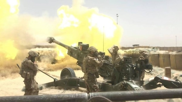 Soldiers from 1st Stryker Brigade Combat Team, 4th Infantry Division conduct a fire mission with a M777 Howitzer in Afghanistan, Aug. 16, 2018. (Spc. Markus Bowling/Army)
