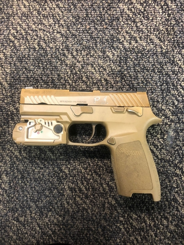 The Army's small arms team at its Lethality Branch are evaluating two submissions for the future laser/light combination for the Modular Handgun System the same device will fit on both the full-size M17 and compact M18 (pictured here) pistols. (Army)