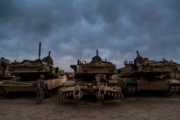 Soldiers with 2nd Brigade Combat Team, 1st Cavalry Division, prepare their M1 Abrams tanks for movement at the National Training Center at Fort Irwin, Calif., Feb. 17, 2017. (Spc. David Devich/Army)