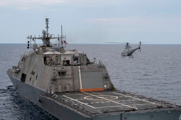 An MQ-8B Fire Scout UAV conducts flight operations alongside the Freedom-class LCS Milwaukee in the Atlantic Ocean. (MC2 Anderson Branch/U.S. Navy)