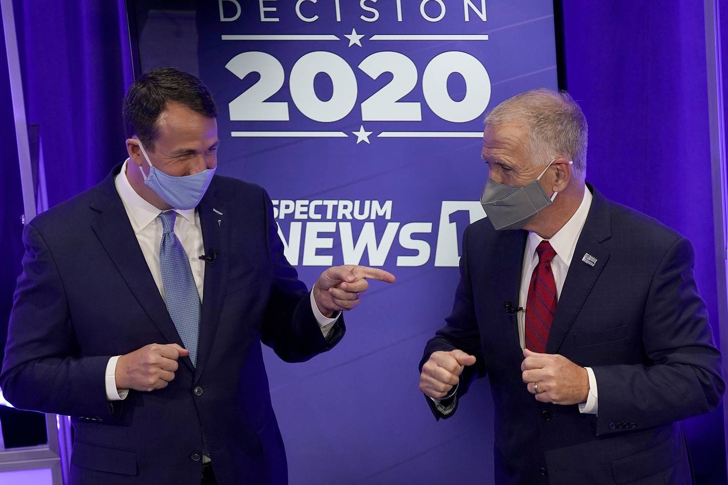 Democratic challenger Cal Cunningham, left, and U.S. Sen. Thom Tillis, R-N.C. greet each other after a televised debate Oct. 1, 2020, in Raleigh, N.C.