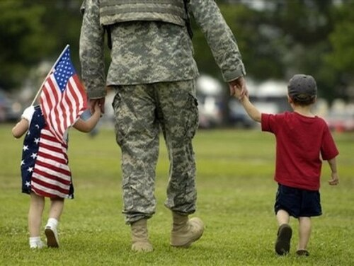 Service member with young children, a new spouse or other major life developments need to update their life insurance to ensure it matches their redefined priorities. (Stephen Morton/AP)