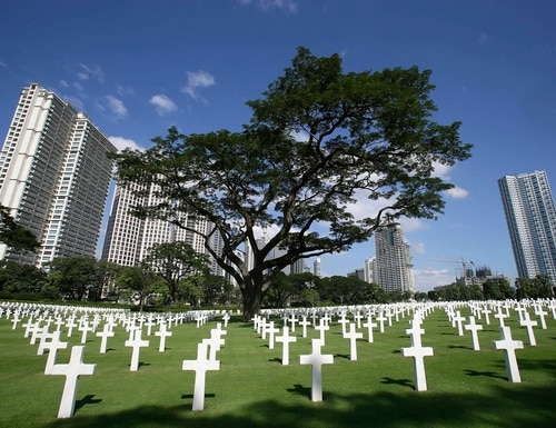 In this Nov. 11, 2012, file photo, rows of crosses totaling 16,933 Latin crosses, 164 Stars of David and 3,740 unknowns, dot the 152-acre American Cemetery on U.S. Veterans Day at the American Cemetery at suburban Taguig city, east of Manila, Philippines. (Bullit Marquez/AP)