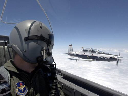 A T-6 Texan pilot flies in formation over Laughlin Air Force Base, Texas. The 19th Air Force's fleet of T-6 trainers were grounded in February after 13 unexplained events such as hypoxia in a single week. There have been 12 more cases since the grounding was lifted Feb. 27. (Tech. Sgt. Jeffrey Allen/Air Force)