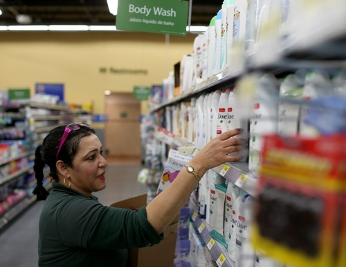 MIAMI, FL - FEBRUARY 19: Walmart employee Clara Martinez stocks the shelves at a Walmart store on February 19, 2015 in Miami, Florida. The Walmart company announced Thursday that it will raise the wages of its store employees to $10 per hour by next February, bringing pay hikes to an estimated 500,000 workers. (Photo by Joe Raedle/Getty Images)