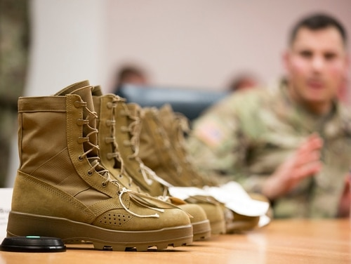 Capt. Daniel Ferenczy, assistant product manager for extreme-weather clothing and footwear at PEO Soldier. discusses the features of the Army's new Hot Weather Uniform and updated Jungle Combat Boot Dec. 7 at Fort Belvoir, Va. (Alan Lessig/Staff)