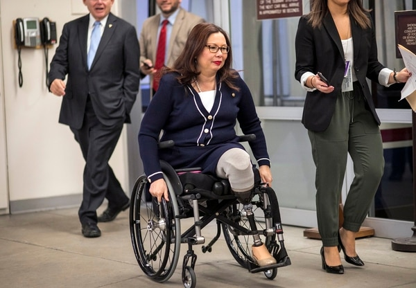 Sen. Tammy Duckworth, D-Illinois, arrives for a vote at the Capitol on Jan. 24, 2018. On Tuesday, the 15-year anniversary of the start of the war in Iraq, Duckworth said she worries that Congress still doesn't take its role overseeing military operations seriously enough. (J. Scott Applewhite/AP)