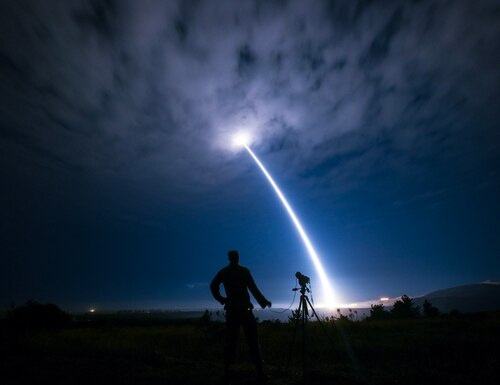 Senior Airman Ian Dudley, 30th Space Wing Public Affairs photojournalist, photographs an unarmed Minuteman III intercontinental ballistic missile during an operational test Aug. 2, 2017, at Vandenberg Air Force Base, Calif. (U.S. Air Force photo by Senior Airman Ian Dudley/Released)