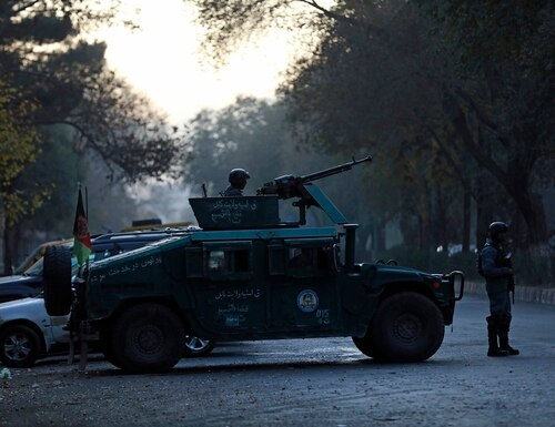 Afghan police patrol at the site of an attack at Kabul University in Kabul, Afghanistan, Monday, Nov. 2, 2020. (Rahmat Gul/AP)