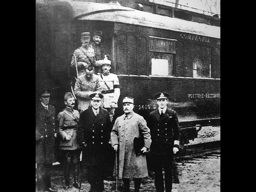 This undated file photo shows the train wagon in which the armistice of 1918 ending World War I was signed on Nov. 11, 1918, in Rethondes, north of Paris. Standing in front of the train are the most important members of the armistice, Marshal Ferdinand Foch, second right, and General Maxime Weygand, second left. For the French, the dining car became a shrine to peace. For Adolf Hitler, it was a symbol of the humiliation of surrender. The Nazi leader had it dragged to Germany after conquering France in World War II. (AP Photo)