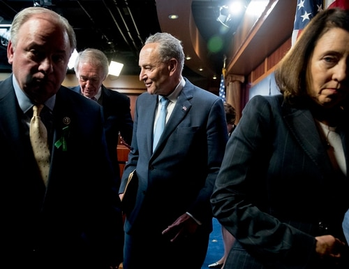 From left, Rep. Mike Doyle, D-Pa., Sen. Ed Markey, D-Mass., Senate Minority Leader Sen. Chuck Schumer of N.Y., and Sen. Maria Cantwell, D-Wash., leave a news conference on Capitol Hill in Washington, Wednesday, May 16, 2018, after the Senate passed a resolution to reverse the FCC decision to end net neutrality. (Andrew Harnik/AP)