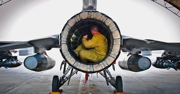 An airman conducts a post-flight inspection on an F-16 Fighting Falcon in Afghanistan. The age of the fourth-generation fighters adds to the difficulty of reaching 80 percent readiness rates. (Senior Airman Scott Saldukas/Air Force)