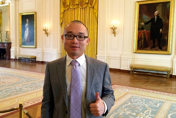 This photo provided by Panshu Zhao shows Zhao at the White House on April 21, 2018. (Panshu Zhao via AP)