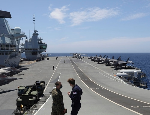 Military personnel participate in the NATO Steadfast Defender 2021 exercise on the deck of the aircraft carrier HMS Queen Elizabeth off the coast of Portugal on May 27, 2021. (Ana Brigida/AP)