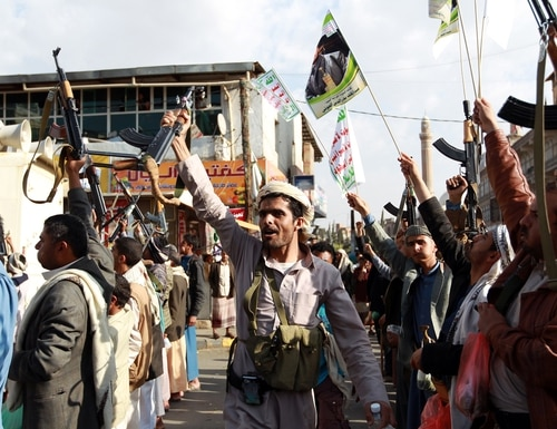Tribal gunmen loyal to the Houthi movement brandish weapons in the capital of Yemen on April 1, 2015. Some politicians in Finland are concerned about the sale of materiel to Middle Eastern states engaged in military conflict. (Mohammed Huwais/AFP via Getty Images)
