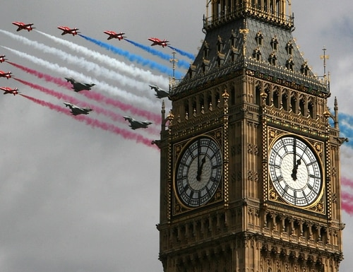 The Royal Air Force Red Arrows fly in formation with four Typhoon aircraft over central London on April 1, 2008, in England. (Cate Gillon/Getty Images)