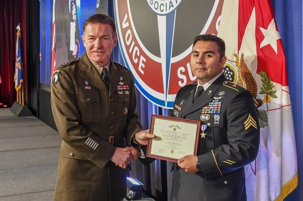 Vice Chief of Staff Gen. James McConville presents the Silver Star to Sgt. Armando Yanez. (Sgt. Steven Lopez/Army)