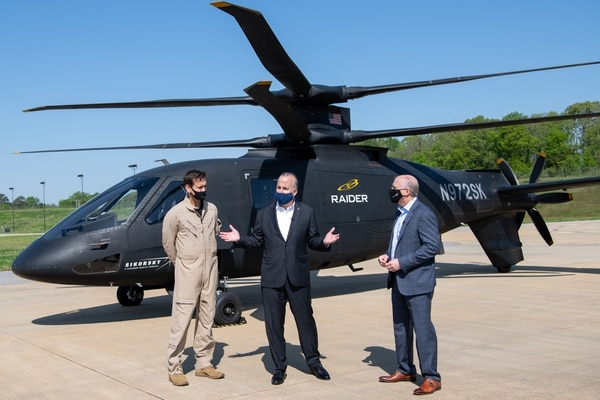 From left, Sikorsky pilot Christiaan Corry, Sikorsky President Paul Lemmo and Sikorsky Vice President of Future Vertical Lift Andy Adams discuss the S-97 Raider variants during a flight demonstration at Redstone Arsenal, Ala., in April 2021. (Courtesy of Lockheed Martin)