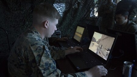 A Marine uses Virtual Battle Space 3 in Camp Lejeune, North Carolina. VBS 3 is part of the Tactical Decision Kit developed jointly by Marine Corps Systems Command, the Marine Corps Warfighting Lab's Rapid Capabilities Office and the Office of Naval Research. (Lance Cpl. Alexis C. Schneider/Marine Corps)
