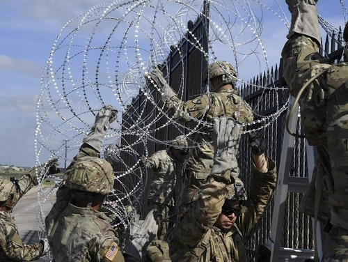 Soldiers from various engineering units install concertina wire Nov. 5, 2018, on the Anzalduas International Bridge, Texas. (Airman First Class Daniel A. Hernandez/Air Force)