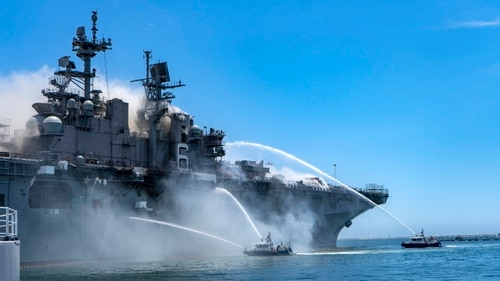 Port of San Diego Harbor Police Department boats combat a fire on board the amphibious assault ship Bonhomme Richard at Naval Base San Diego July 12. The Bonhomme Richard was going through a maintenance availability that began in 2018. (MC3 Christina Ross/Navy)