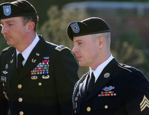 Army Sgt. Bowe Bergdahl, right, arrives for a pretrial hearing at Fort Bragg, N.C., with his defense counsel Lt. Col. Franklin D. Rosenblatt, left, on Tuesday, Jan. 12, 2016. (AP Photo/Ted Richardson)