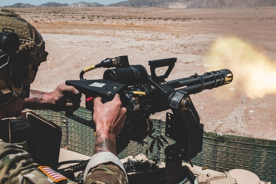 A U.S. Army Special Operation Soldier with 3rd Battalion, 7th Special Forces Group (Airborne) fires a MK44 minigun during Integrated Training Exercise 3-19 at Marine Corps Air-Ground Combat Center Twentynine Palms (MCAGCC), Calif., May 4, 2019. (U.S. Marine Corps photo by Lance Cpl. William Chockey)