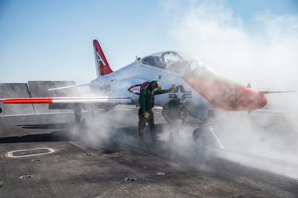 A T-45C Goshawk assigned to Carrier Training Wing 1 in early 2017 prepared to launch from the flight deck of the aircraft carrier Dwight D. Eisenhower while Ike was underway in the Atlantic Ocean. (Navy)