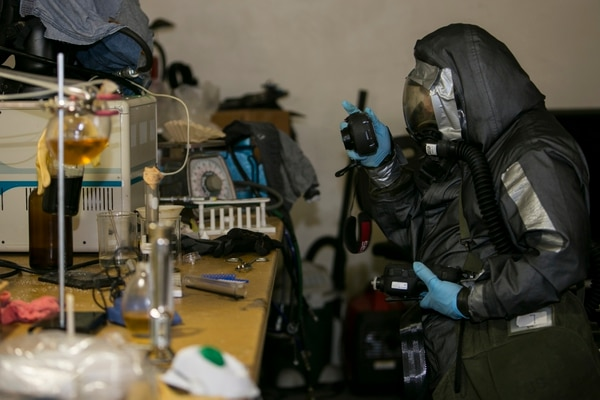Chemical Biological Radiological Nuclear (CBRN) Defense Marines captures photographs of a clandestine laboratory for situational awareness for the CBRN sampling team during a simulated CBRN response drill on Camp Foster, Okinawa, Japan, in August 2016. (Lance Cpl. Sean Evans/Marine Corps)