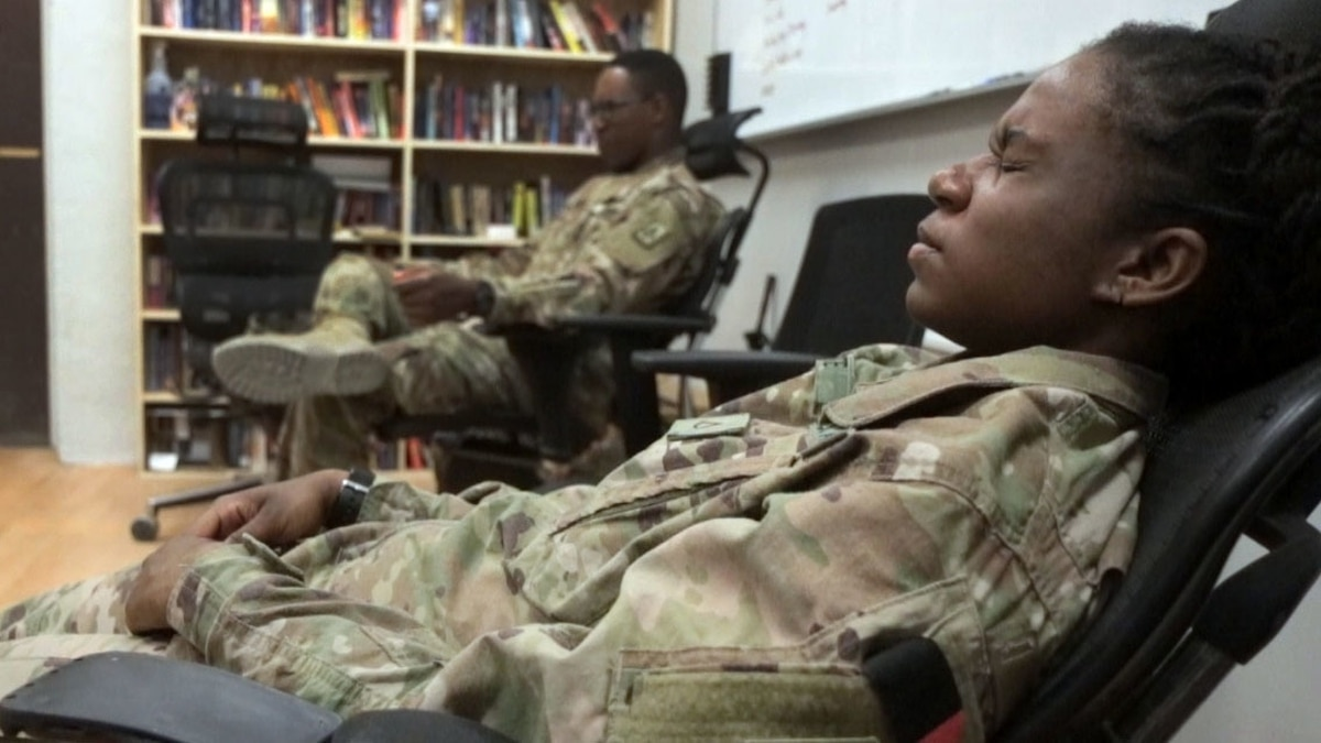 Pfc. Linaeja White, a health care specialist with Special Troops Battalion, 3rd Infantry Division Resolute Support Sustainment Brigade, scrunches up her face on April 2, 2018, during a Mindfulness Monday class at Bagram Airfield, Afghanistan. Therapies such as transcendental meditation are effective in treating PTSD.
