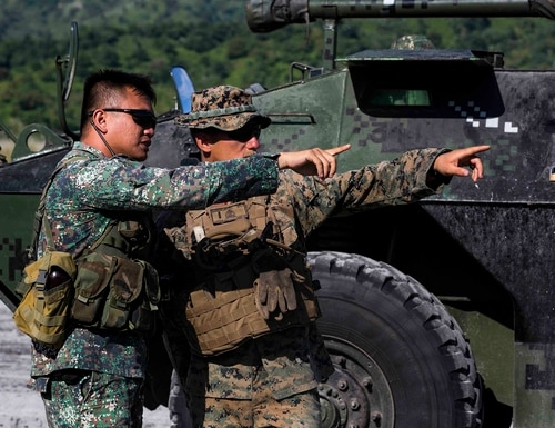 U.S. Marine 1st Lt. Alec Barrowcliff speaks with a Philippine Marine on the plan of attack during the final exercise of KAMANDAG 3 at Colonel Ernesto P. Ravina Air Base, Philippines, Oct. 17 2019. (Lance Cpl. Christian Ayers/Marine Corps)
