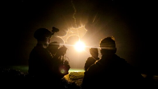 U.S. Marines watch illuminating rounds during a simulated close-air support and assault support training event at W-174, Okinawa, Japan, Aug. 18, 2020. (Cpl. Kealii De Los Santos/Marine Corps)