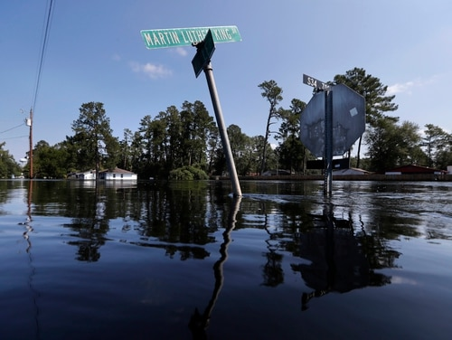 Street signs protrude through floodwaters in the aftermath of Hurricane Florence in Nichols, S.C., on Sept. 21, 2018. VA officials announced they will fast-track appeals claims of veterans who live in areas affected by the devastating storms. (Gerald Herbert/AP)