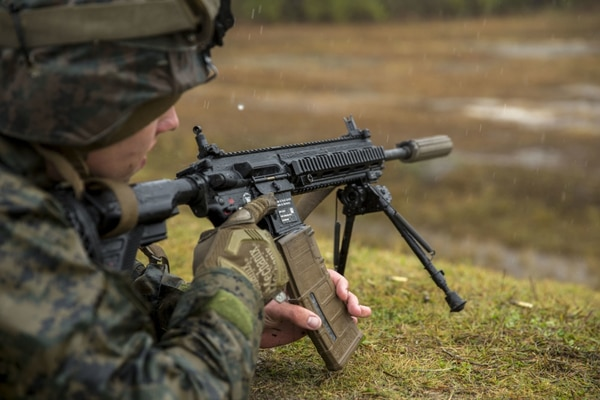 U.S. Marines with 3rd Battalion 8th Marine Regiment fire the M27 Infantry Automatic Rifle during a live-fire weapons exercise at range F-18 on Camp Lejeune, North Carolina in 2017. (Lance Cpl. Michaela R. Gregory/ Marine Corps)